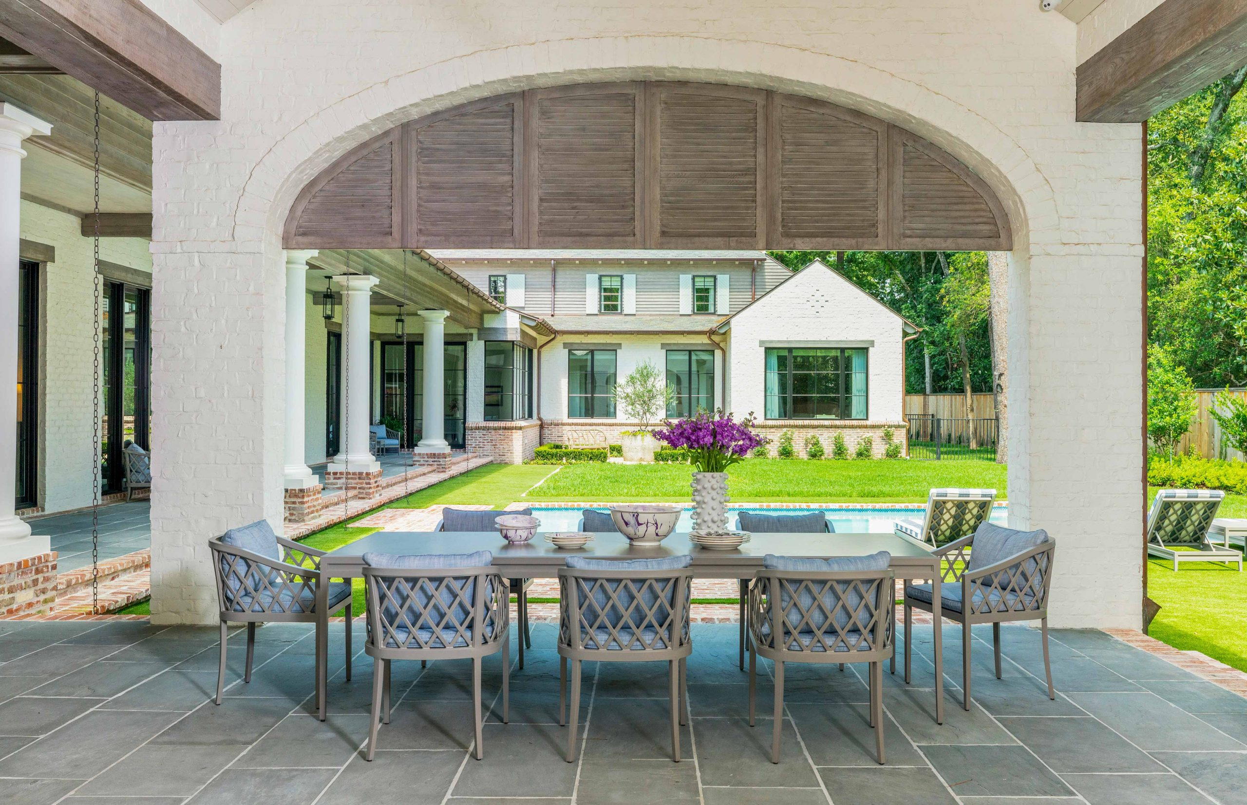 outdoor dining set with pool and yard - Creative Tonic