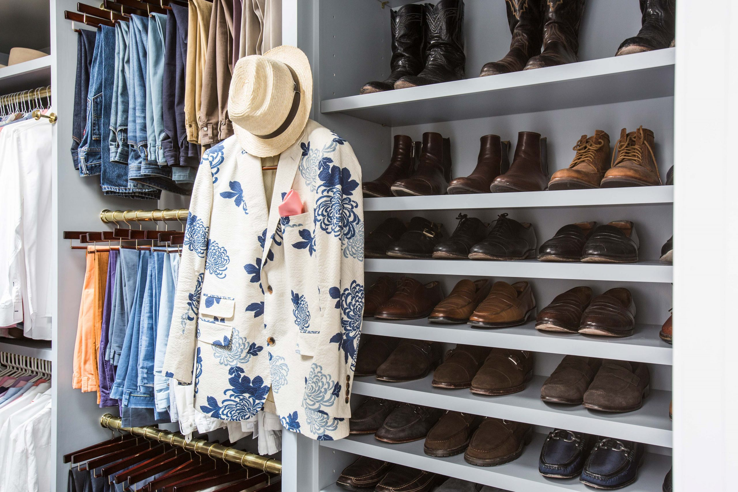 mens walk in closet with shoe space and hanging rack - Creative Tonic