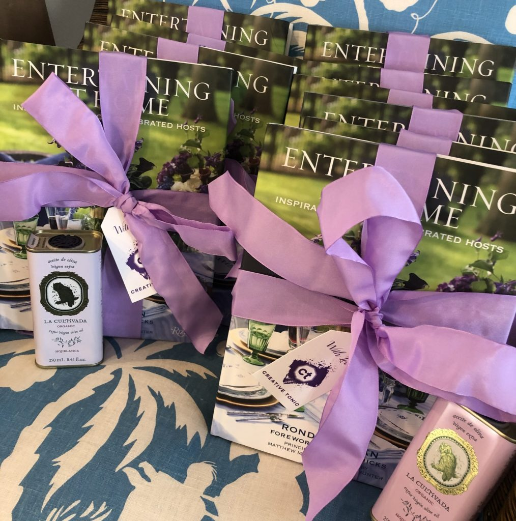 book and olive oil party favor